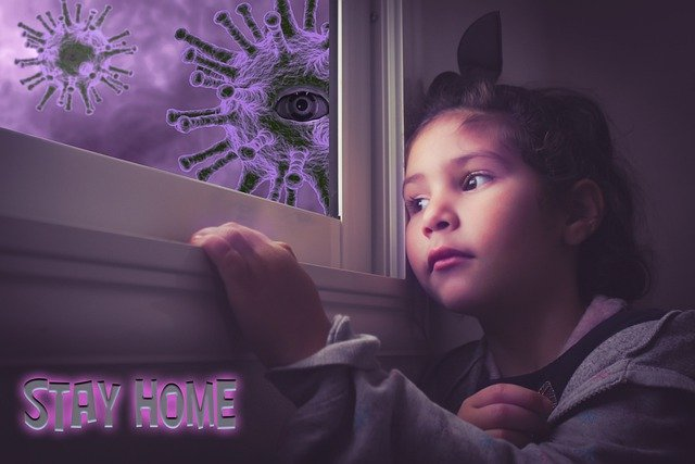 A young child looking out of a window, with lots of Covid19 virus particles floating in the air outside.